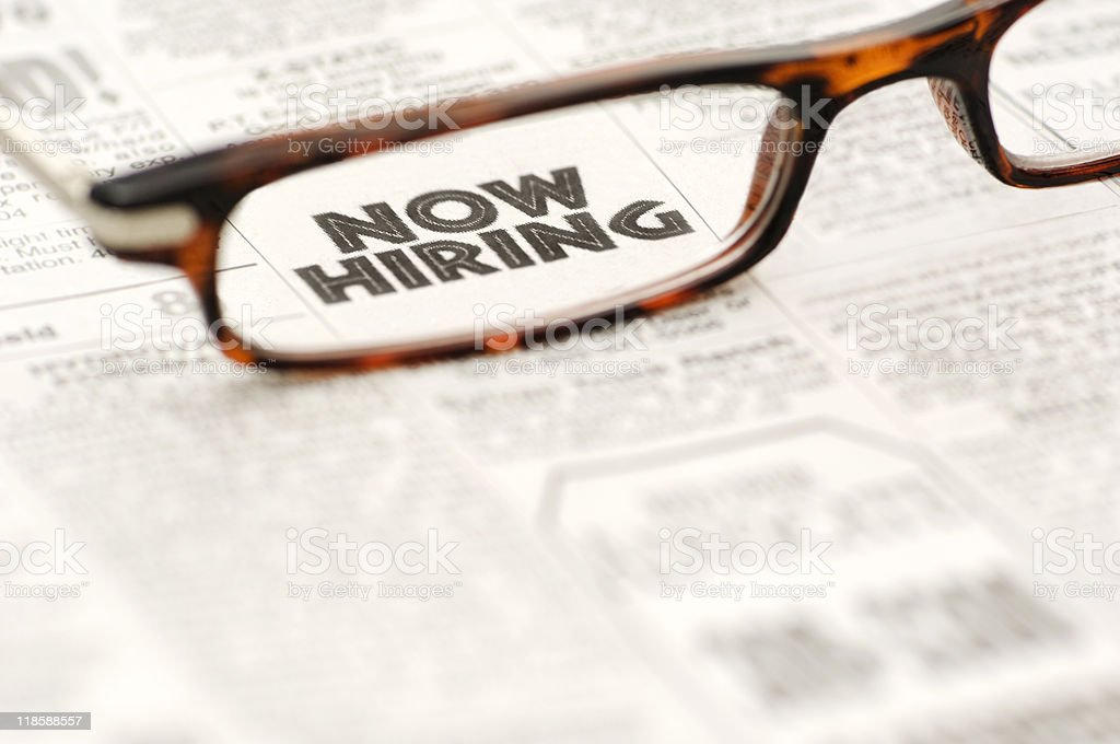 Now Hiring classified ad framed in glasses stock photo