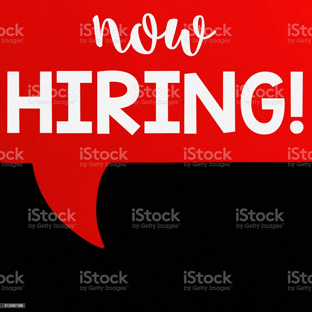 Now Hiring sign on black chalkboard background stock photo