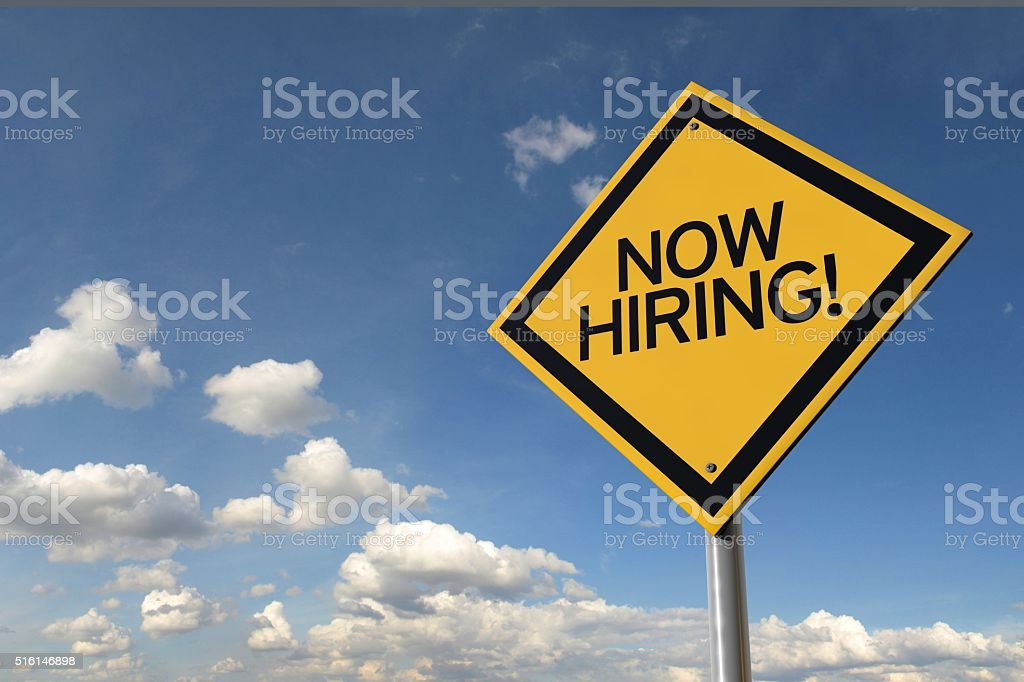 Now hiring yellow highway road sign stock photo