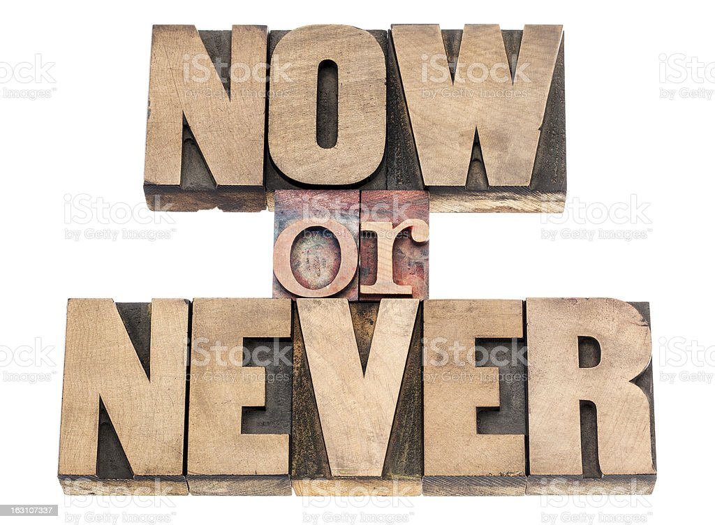 now or never in wood type royalty-free stock photo