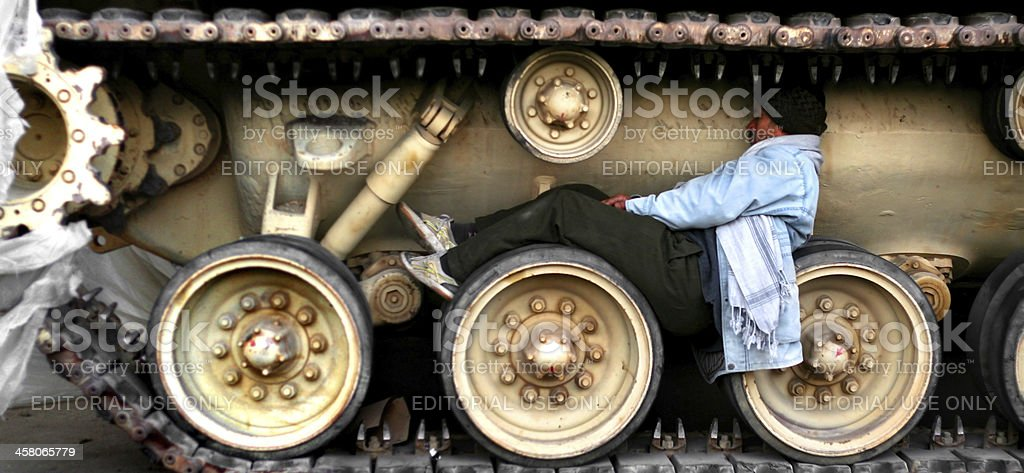nowhere to sleep other than a comfy tank tread wheel stock photo