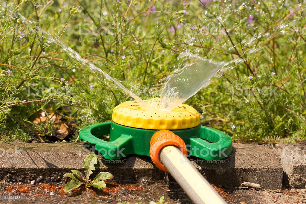 nozzle automatic watering system against a background stock photo