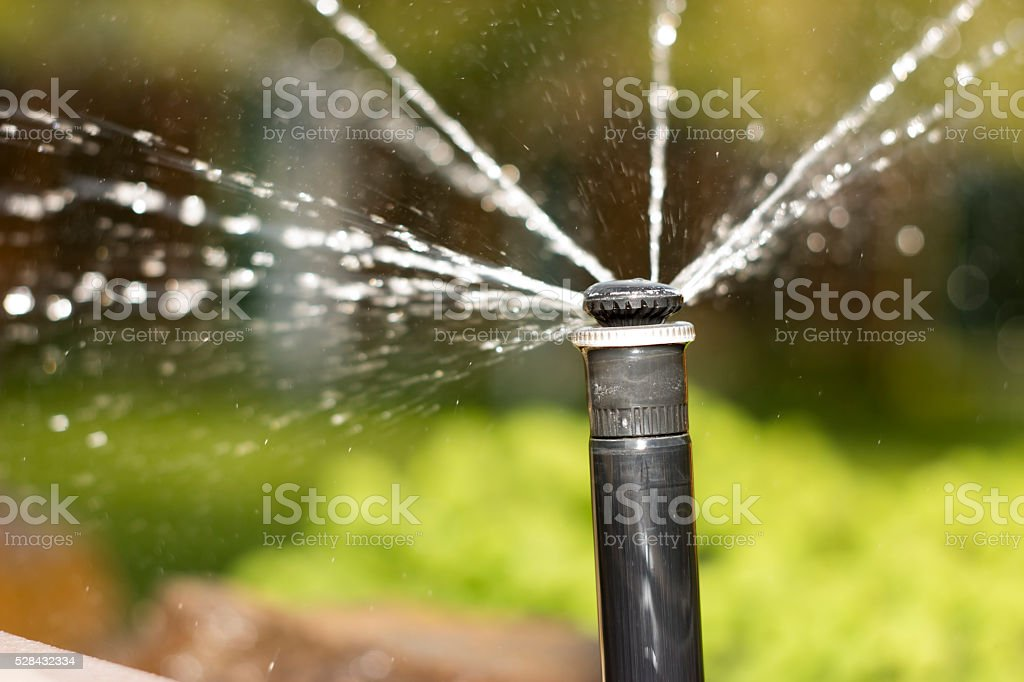 nozzle automatic watering system against stock photo