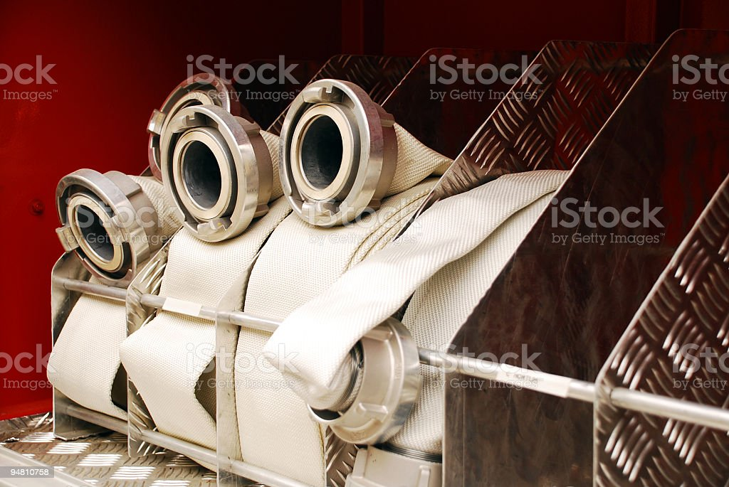 Nozzles in metal cabinet stock photo