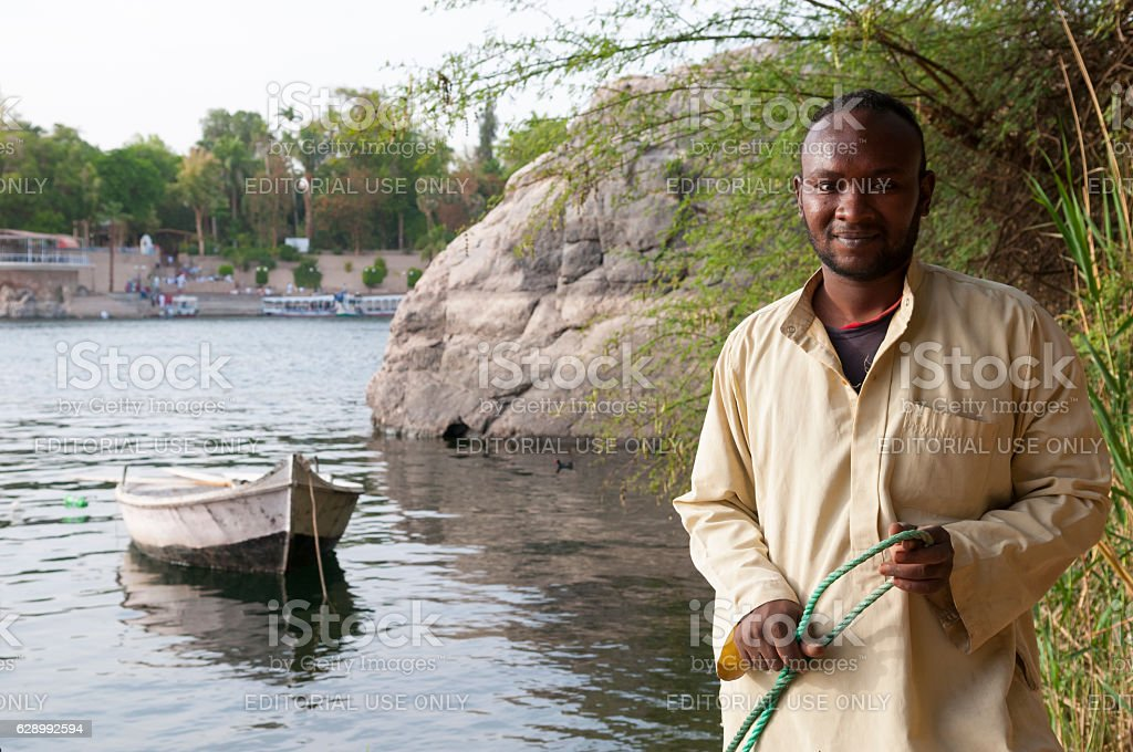 Nubian man at Nile River in Aswan, Egypt stock photo