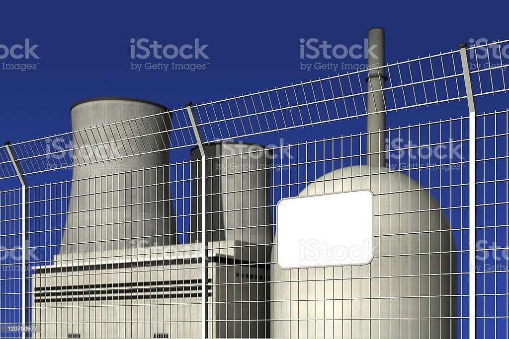 Nuclear power plant behind a barrier fence royalty-free stock photo