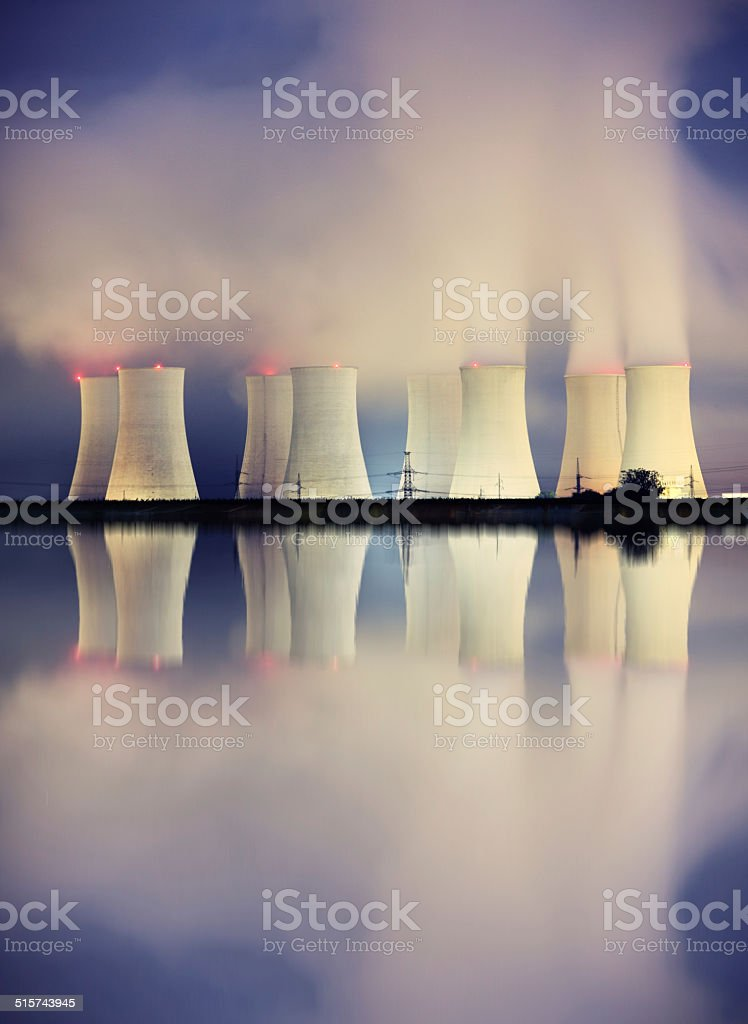 Nuclear power plant by night stock photo