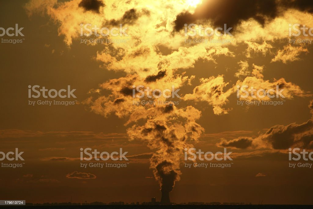 Nuclear power plant polluting the sky royalty-free stock photo
