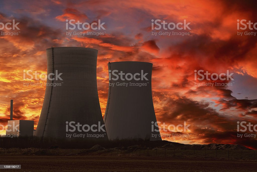 Nuclear power plant with an intense red sky stock photo