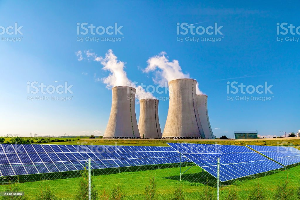 Nuclear power plant with energy solar panels stock photo