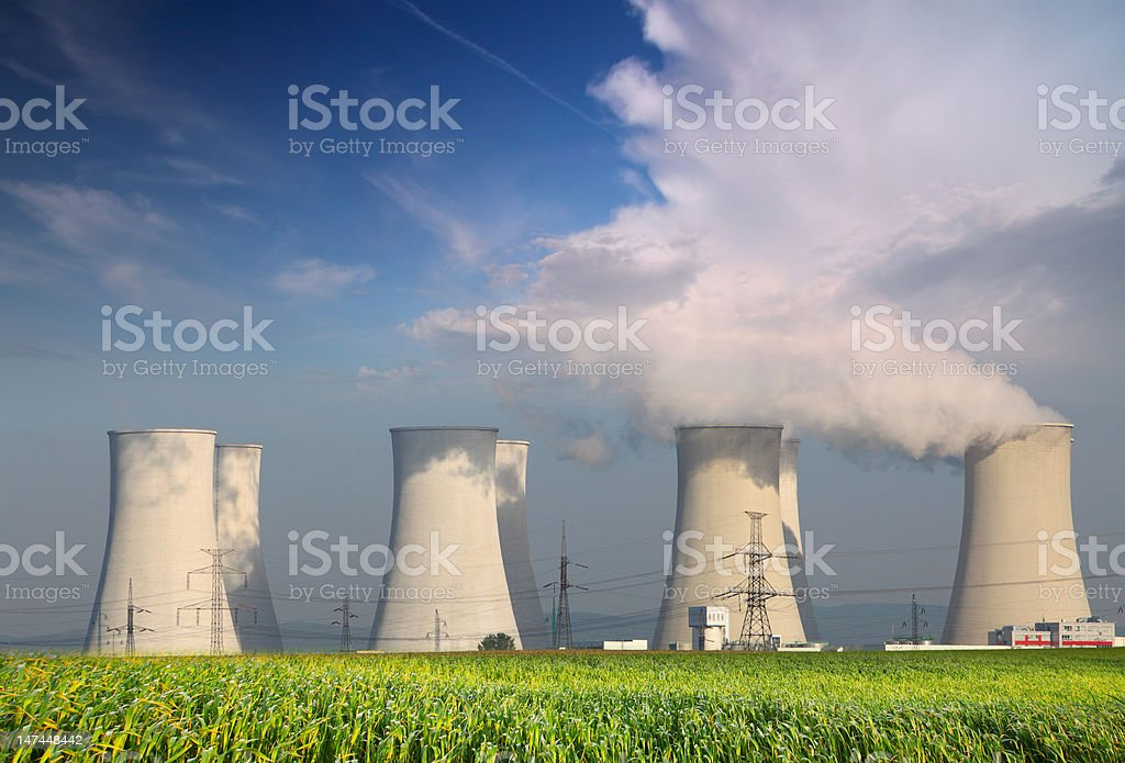Nuclear Power plant with  field and blue sky stock photo