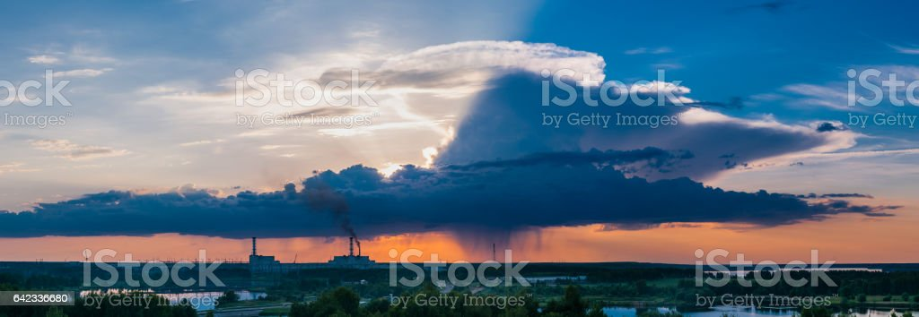Nuclear power plant with intense blue and cloudy sky stock photo