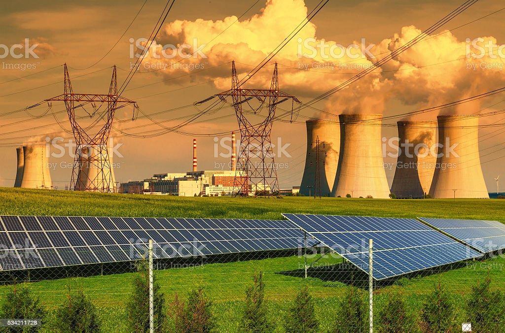 Nuclear power plant with solar panels at sunset stock photo