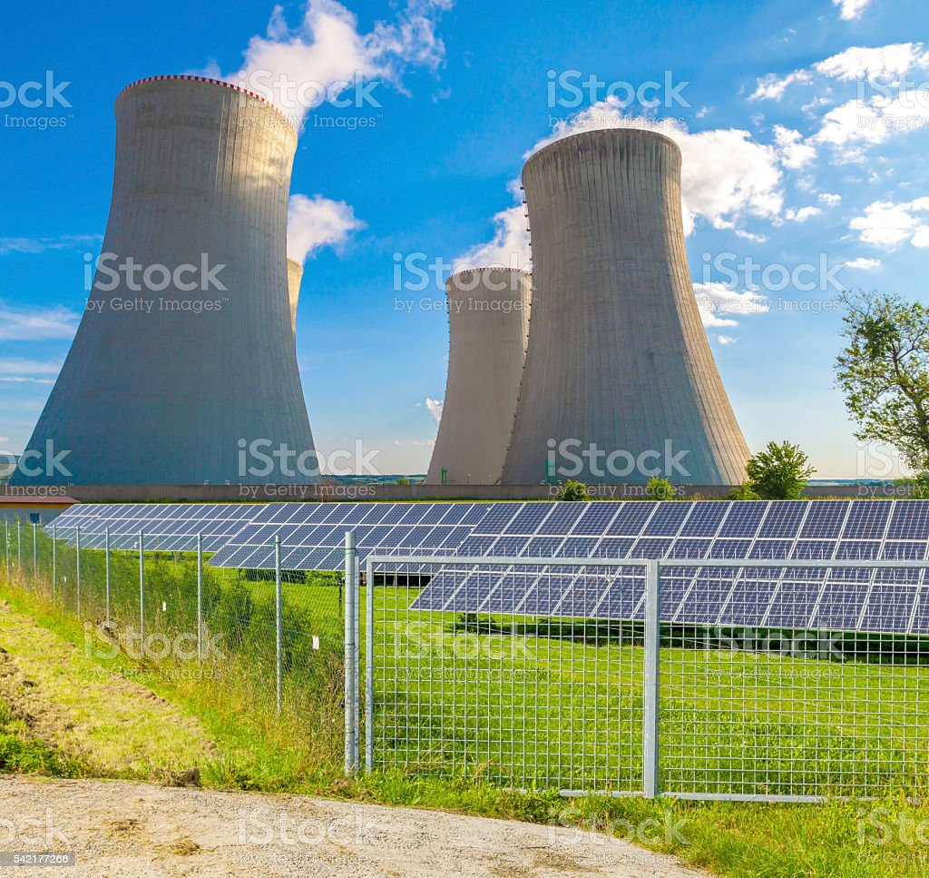 Nuclear power plant with solar panels stock photo