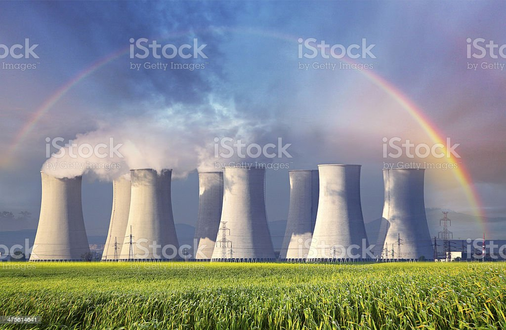 Nuclear power plant with summer field stock photo