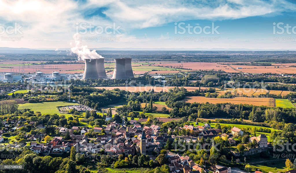 Nuclear power station close to countryside village landscape stock photo