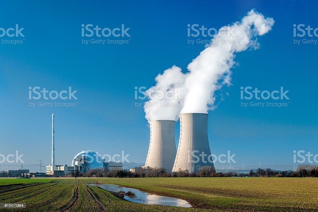 Nuclear power station Grohnde with steaming cooling towers stock photo