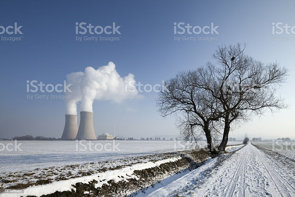 Nuclear power station with steaming cooling towers countryside in winter stock photo
