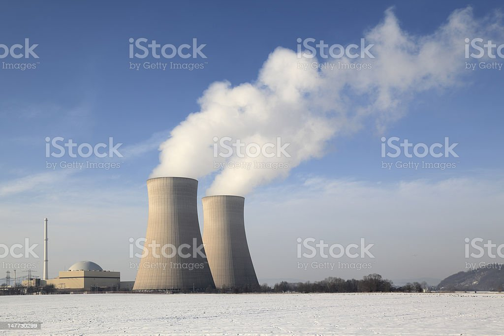 Nuclear power station with steaming cooling towers in winter (XXXL) stock photo