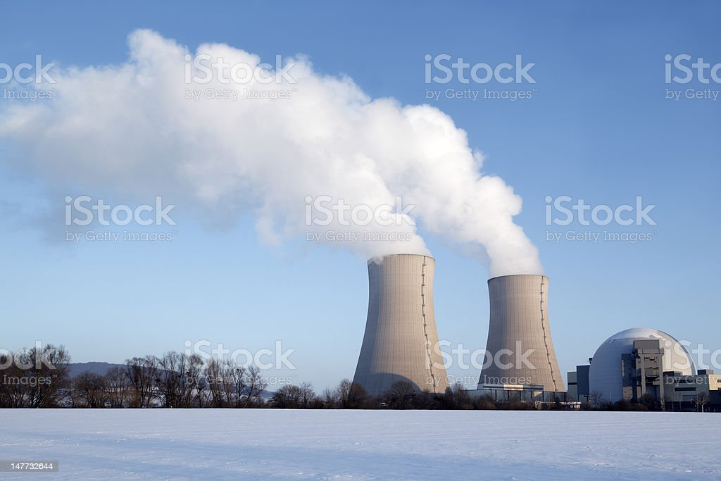 Nuclear power station with steaming cooling towers in winter (XXL) stock photo