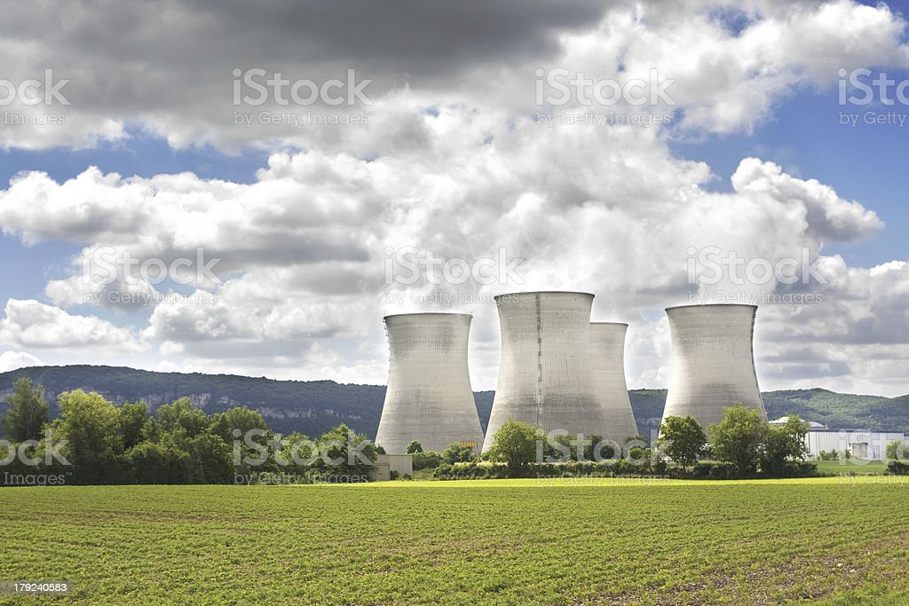 Nuclear power station with steaming cooling towers royalty-free stock photo