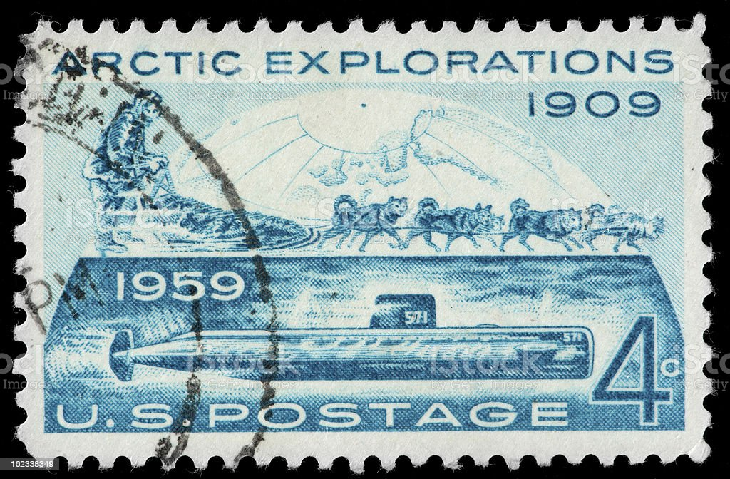 Nuclear Powered Submarine,  Artic Sled Dogs, Vintage US Postage Stamp stock photo
