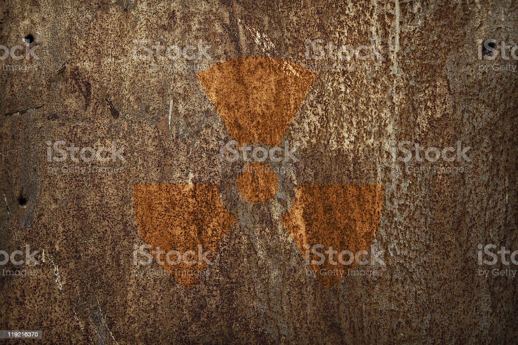 nuclear radiation sign on rusty metal texture royalty-free stock photo