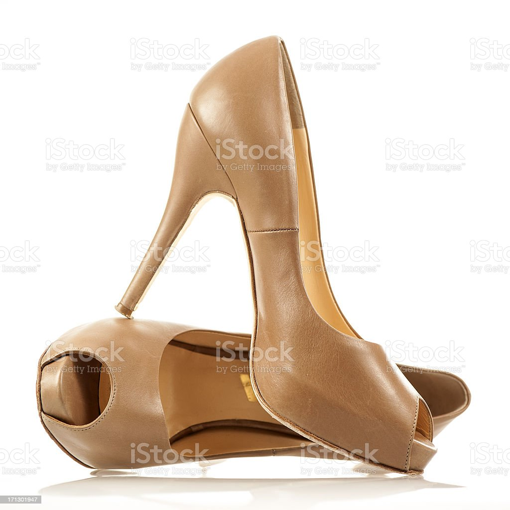 Nude colored, elegant high heels with a peep toe stock photo