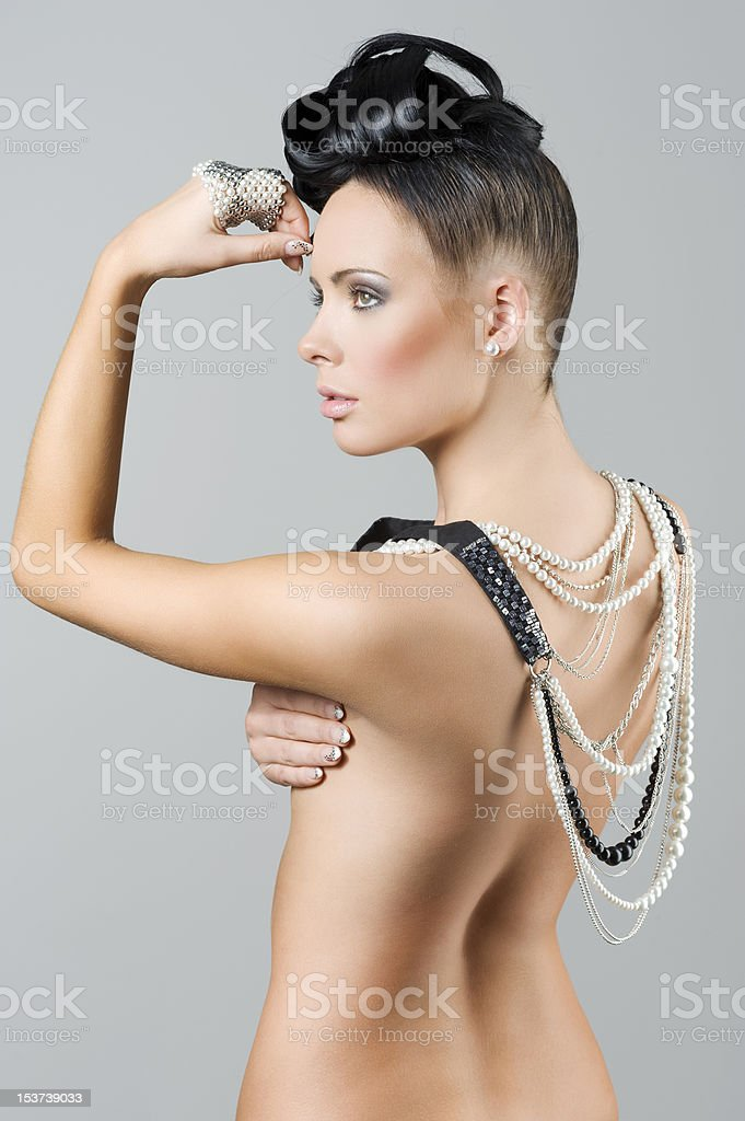 nude girl with necklace and hairstyle royalty-free stock photo