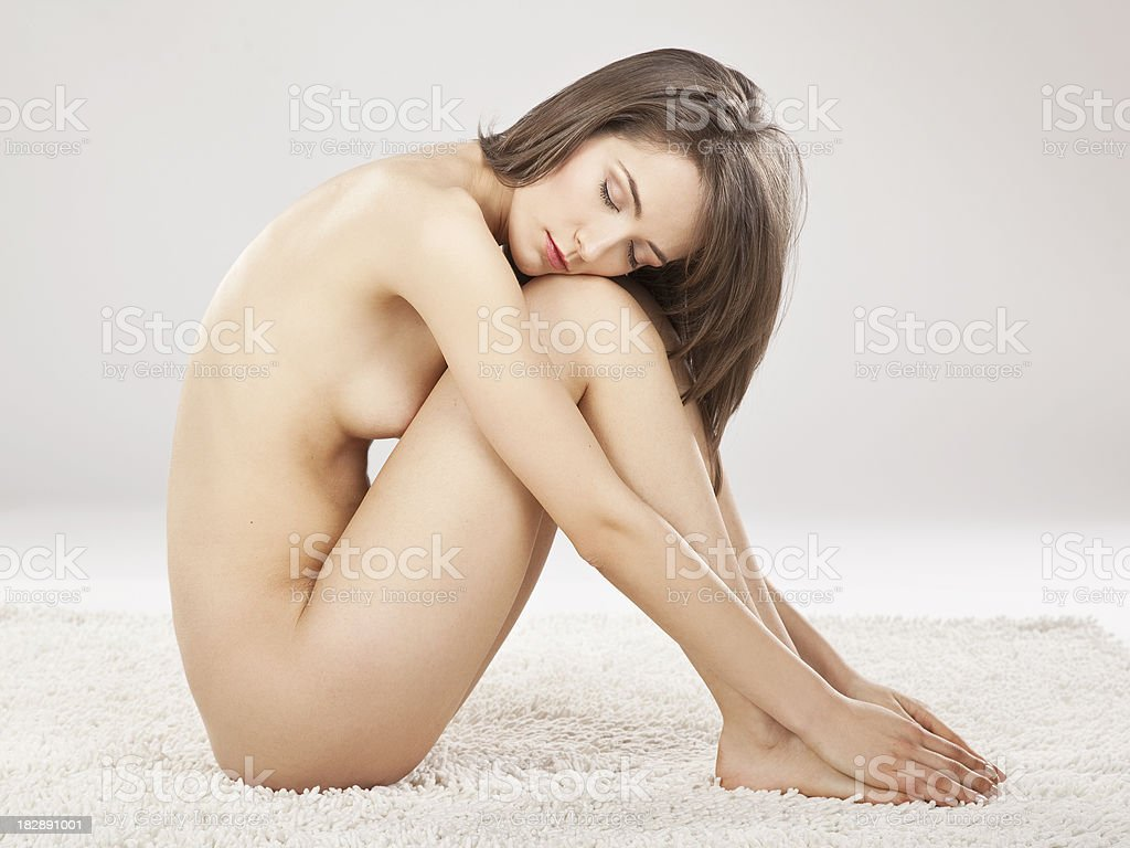 Nude woman sitting royalty-free stock photo