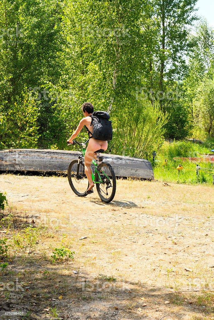 nudist woman  on bicycle stock photo