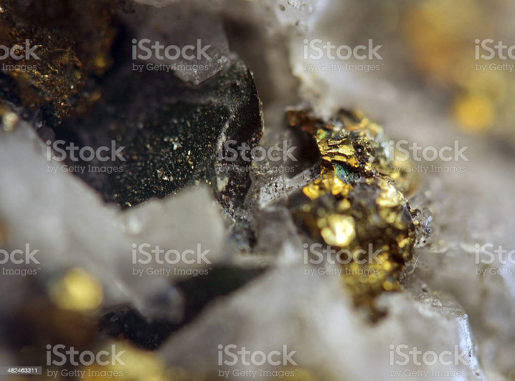 Nugget, gold, bronze, copper, iron. Macro. Extreme closeup stock photo