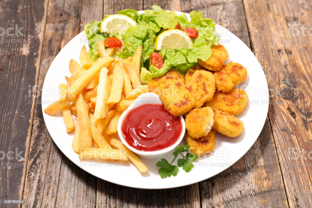 nugget,french fries and vegetable stock photo
