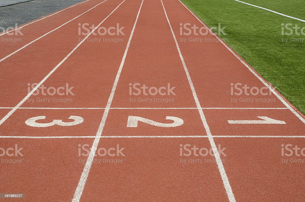 Number 1 2 3 on race track in football stadium. stock photo