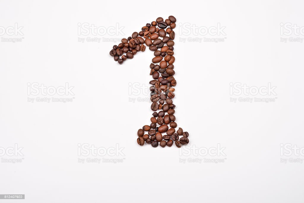 Number 1 from coffee beans on white background. Morning pleasure stock photo
