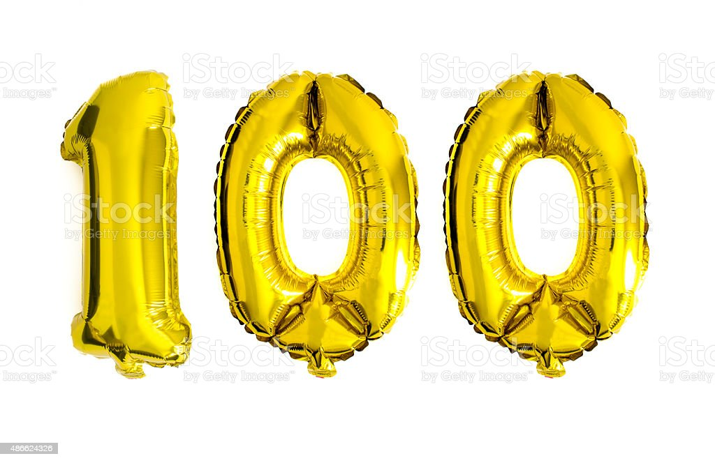 Number 100 written with golden foil helium balloons stock photo