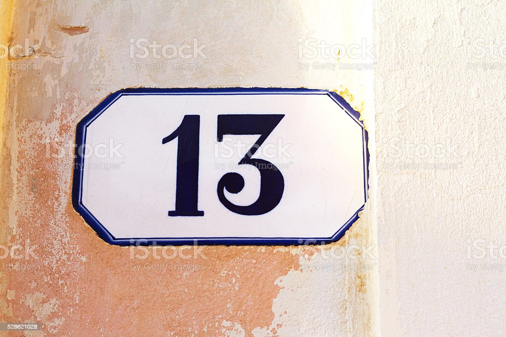 Number 13 Ceramic Address Plaque in Pastel-Pink Wall stock photo