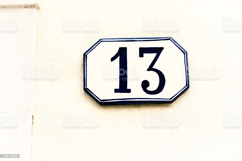 Number 13 Ceramic Street Address Tile On White Wall stock photo