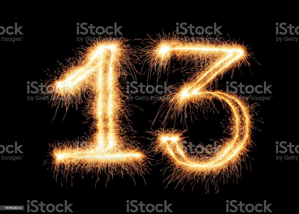 Number 13 outlined in festive sparkler lights stock photo