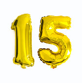 Number 15 written with foil balloons