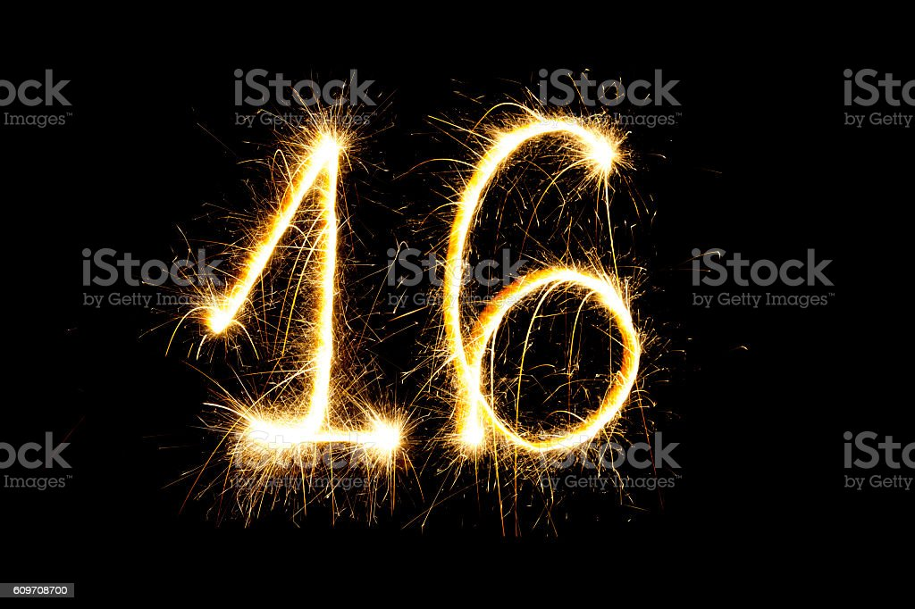 Number 16 made with sparklers stock photo