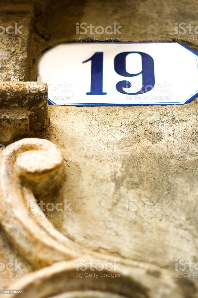 Number 19 Ceramic Street Address Tile, Old Baroque Wall stock photo