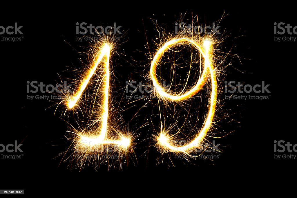 Number 19 made with sparklers stock photo