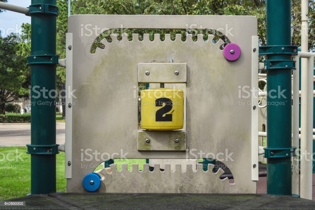 Number 2 is turned on this playground equipment. stock photo