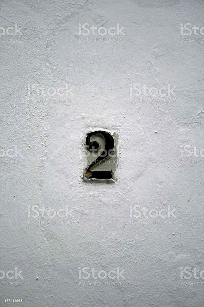 Number 2 (two) on a tile stock photo