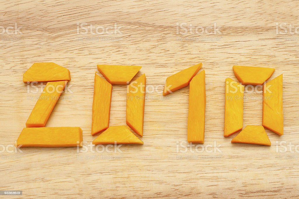 Number 2010  from pumpkin on wooden royalty-free stock photo