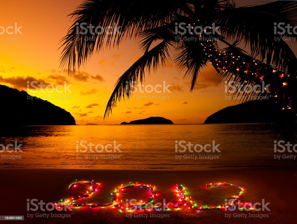 number 2012 made of Christmas lights at the Caribbean beach royalty-free stock photo