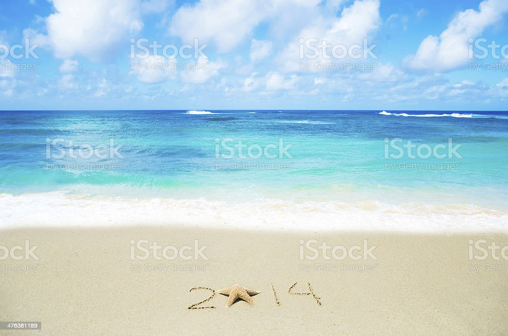 Number 2014 on the sand - holiday concept royalty-free stock photo