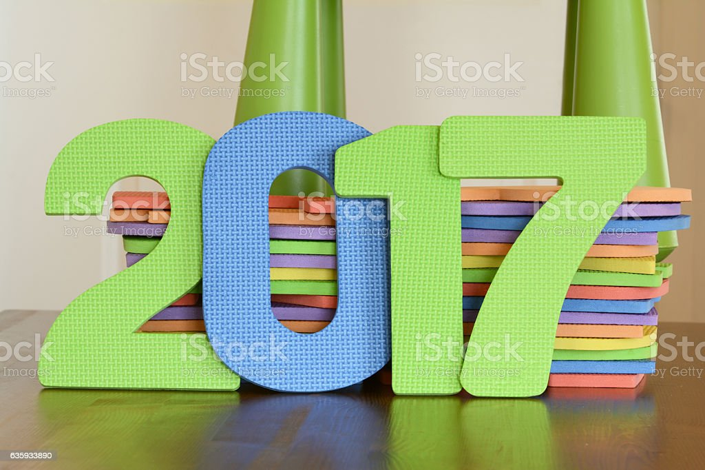 Number 2017 of colorful flat foam toys on a table stock photo