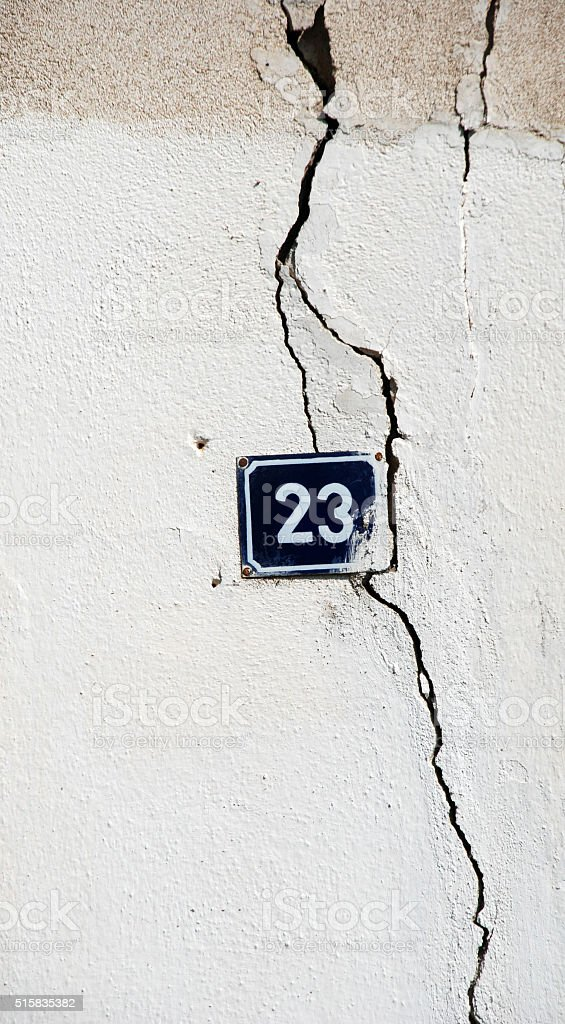 number 23 on a damaged wall stock photo